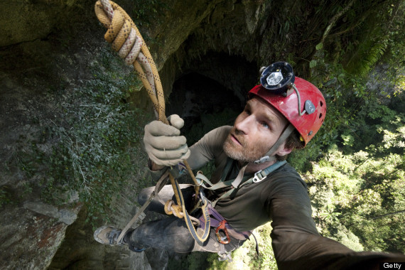 A photographer climbing in Hang Son Doong.